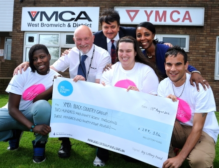 BIG's Dharmendra Kanani pictured with YMCA staff, volunteers and young people