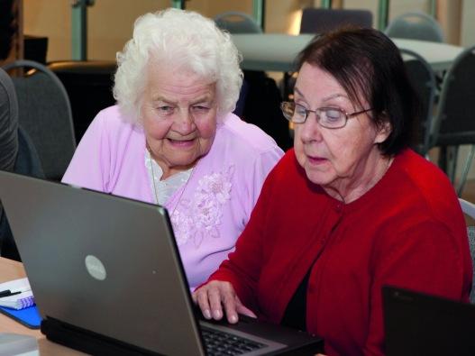 Betty helping at a PC keyboard