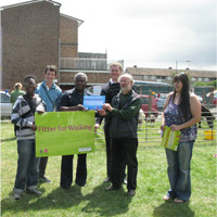 Residents of the Marks Gate Estate receiving their Fitter for Walking Award
