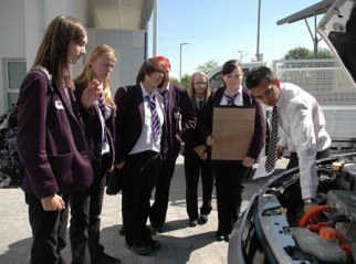 Pupils are shown the workings of car engine