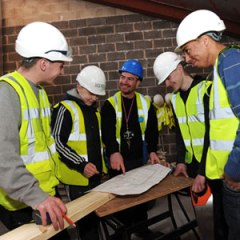 Young people and tradesman discuss a DIY project