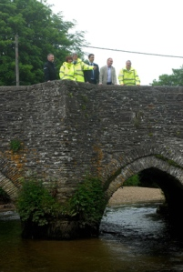 Cornwall Community Flood Forum group at Lostwithiel's medieval bridge over the River Fowey