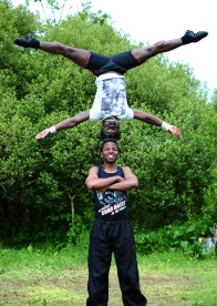 a man does headstand on another mans head