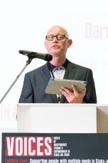 Darren making speech at a lectern
