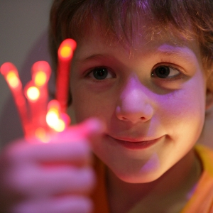 Close up of child playing with lights