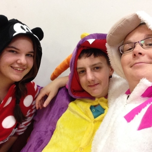 Connor and two other young people in onsies