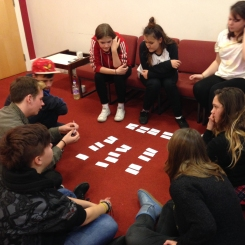Group of young people looking at cards
