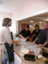Tom Baker and three other men baking bread in a kitchen