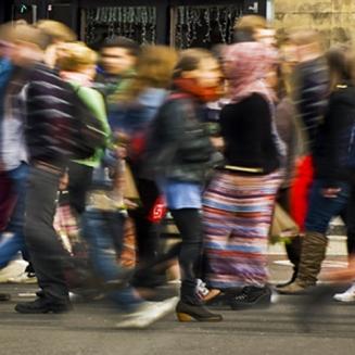 Blurred image of crowd of people walking
