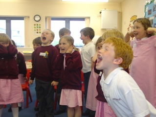A group of children practice yelling as a form of defence