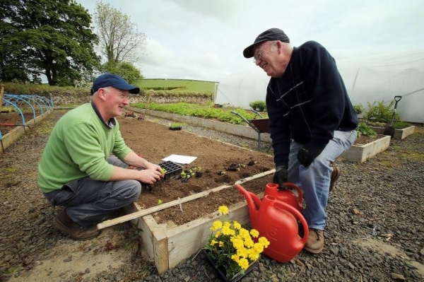 Two people gardening - representing #BigVolunteer