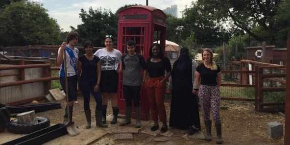Students and Big Lottery Fund staff standing in from of phone box